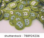 many gold bitcoins laying on... | Shutterstock . vector #788924236