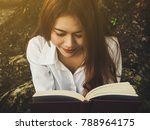 young woman reading book at the ... | Shutterstock . vector #788964175