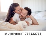 love couple lying on bed.male... | Shutterstock . vector #789122785