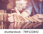 business man placing wooden... | Shutterstock . vector #789122842