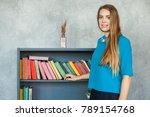 student girl on bookshelves... | Shutterstock . vector #789154768