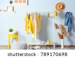 Stock photo collection of clothes hanging on rack in dressing room 789170698