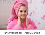 young girl in pink bathrobe use ... | Shutterstock . vector #789221485