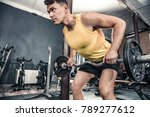 man lifts curl barbell at the... | Shutterstock . vector #789277612