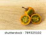 lulos on a wooden background.... | Shutterstock . vector #789325102