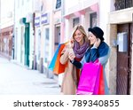 two smiling young woman with... | Shutterstock . vector #789340855