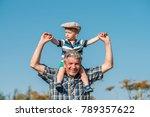 grandfather carries grandson... | Shutterstock . vector #789357622