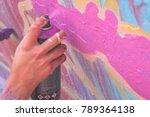 Graffiti Artist Hand Painting...