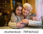an elderly woman in an embrace... | Shutterstock . vector #789364162