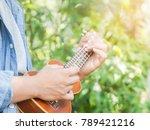 man playing ukulele among... | Shutterstock . vector #789421216