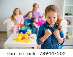 sad girl in kinderarten | Shutterstock . vector #789447502