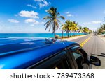 View to sunny street from above a car in Caribbean San-Andres island. - stock photo