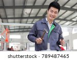 young chinese man works in... | Shutterstock . vector #789487465