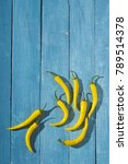 yellow chili peppers on blue... | Shutterstock . vector #789514378