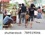 Small photo of A man and a woman kidding each other assume as to fight during tourism festival at Perak Malaysia on 31/12/17.