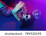 Stock photo sexy disco party woman sunglasses sequin party dress disco balls neon lights bright makeup 789520195