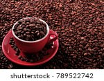 Red Coffee Cup Filled With...