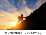 man climbing mountain at... | Shutterstock . vector #789539482