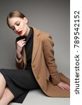 fashionable woman in a coat.... | Shutterstock . vector #789542152
