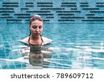 Small photo of Photo of Girl on a Swimming Pool of a Resort