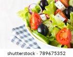 fresh greek salad made of... | Shutterstock . vector #789675352