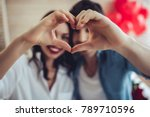 beautiful young couple at home... | Shutterstock . vector #789710596
