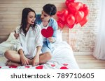 Stock photo beautiful young couple in bedroom celebrating saint valentine s day 789710605