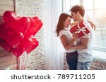 Stock photo beautiful young couple at home hugging kissing and enjoying spending time together while 789711205