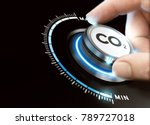 Stock photo man turning a carbon dioxide knob to reduce emissions co reduction or removal concept composite 789727018