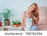 mom and daughter are sitting on ... | Shutterstock . vector #789782296