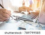 doctor working on laptop... | Shutterstock . vector #789799585
