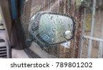 Small photo of Rain adhere at the mirror car.