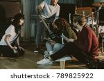 music band sitting on floor and ... | Shutterstock . vector #789825922