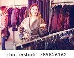 glad girl customer deciding on... | Shutterstock . vector #789856162
