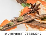 Small photo of Composition of anis, cinnamon and cardamon on white background