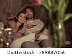happy couple watching tv on... | Shutterstock . vector #789887056