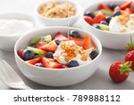 fruit berry salad with yogurt... | Shutterstock . vector #789888112