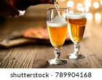 hand pouring fresh beer on a... | Shutterstock . vector #789904168