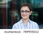 older business woman headshot.... | Shutterstock . vector #789955012