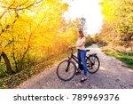 happy woman riding bike in... | Shutterstock . vector #789969376