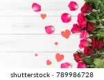 Stock photo red and pink rose with paper heart on white wood bcakground valentine s day concept 789986728