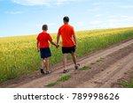 Dad And Child Go Through A Dir...