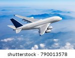 passenger plane flies high over ... | Shutterstock . vector #790013578