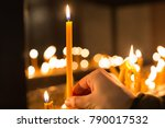 hand holding candle in front of ... | Shutterstock . vector #790017532