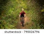 young man riding a mountain bike   Shutterstock . vector #790026796