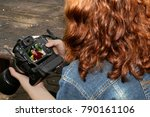 lady check picture in camera. | Shutterstock . vector #790161106