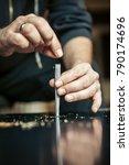 preparing and rolling marijuana ...   Shutterstock . vector #790174696