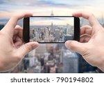 traveler holding smartphone to...   Shutterstock . vector #790194802
