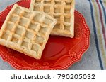 waffle served on a red plate on ... | Shutterstock . vector #790205032