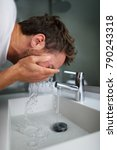 man washing face rinsing soap... | Shutterstock . vector #790243318